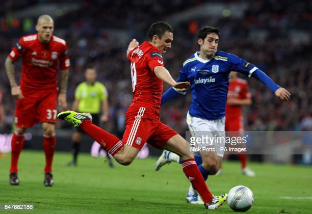 Cardiff City's Peter Whittingham attempts to block the cross from Liverpool's Stewart Downing