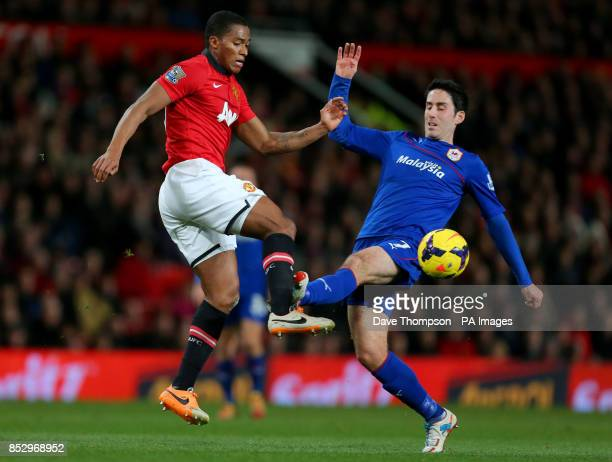 Cardiff City's Peter Whittingham battles for the ball with Manchester United's Luis Antonio Valencia during the Barclays Premier League match at Old...