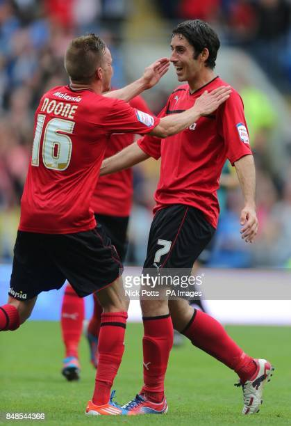 Cardiff City's Peter Whittingham celebrates scoring his third goal with Craig Noone during the npower Football League Championship match at the...