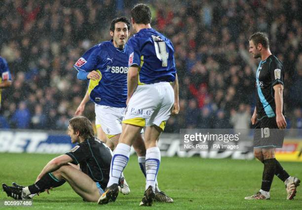 Cardiff City's Peter Whittingham celebrates with Gavin Rae after scoring the second goal as Leicester City players Robbie Neilson and Richie Wellens...