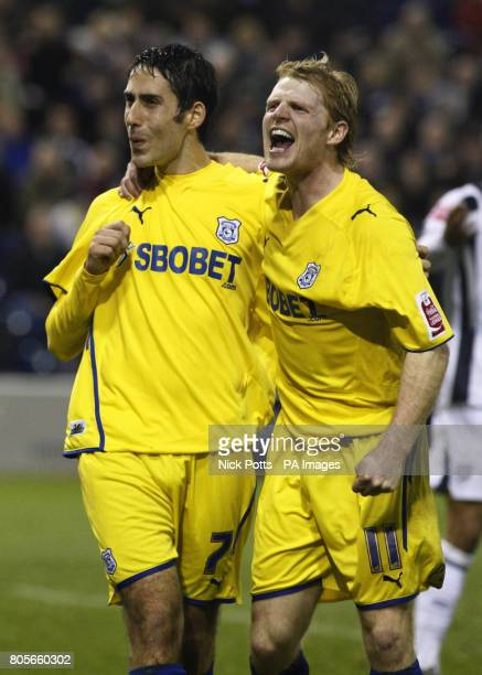 Cardiff City's Peter Whittingham celebrates with teammate Chris Burke after tapping in the rebound from his saved penalty by West Bromwich Albion...