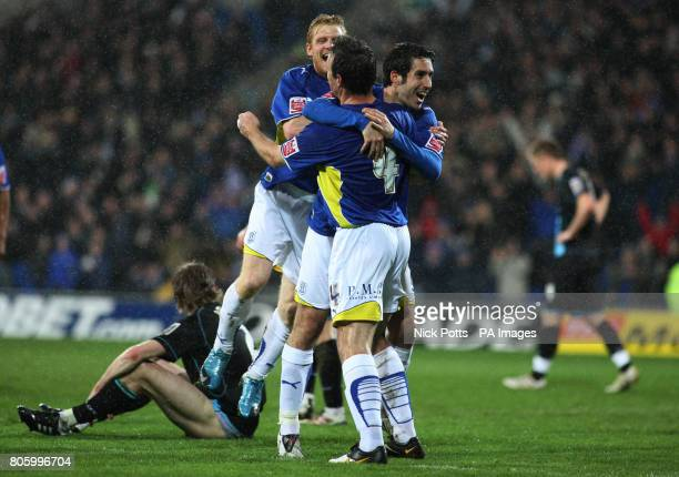 Cardiff City's Peter Whittingham celebrates with teammate Gavin Rae after scoring the his side second goal during the CocaCola Championship match at...