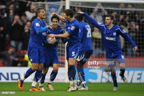 Cardiff City's Peter Whittingham is congratulated by his team mates after scoring their side's first goal from the penalty spot during the npower...