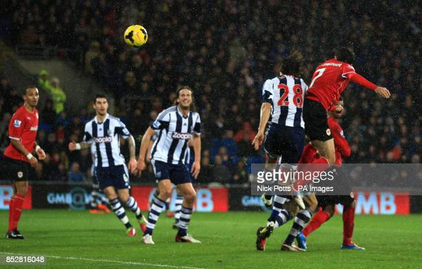 Cardiff City's Peter Whittingham scores the opening goal with header against West Bromwich Albion during the Barclays Premier League match at The...