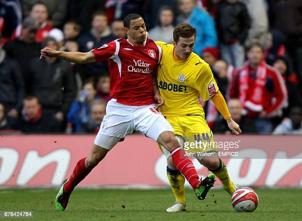 Cardiff City's Ross McCormack and Nottingham Forest's Nathan Tyson battle for the ball