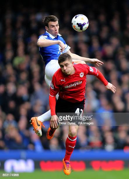 Cardiff City's Seamus Coleman and Cardiff City's Declan John battle for the ball