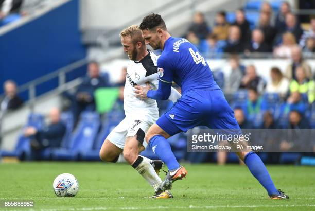 Cardiff City's Sean Morrison and Derby County's Johnny Russell battle for the ball during the Sky Bet Championship match at Cardiff City Stadium