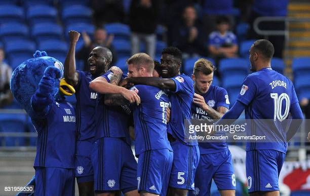 CELE Cardiff City's Sean Morrison celebrates scoring the opening goal with his team mates during the Sky Bet Championship match between Cardiff City...