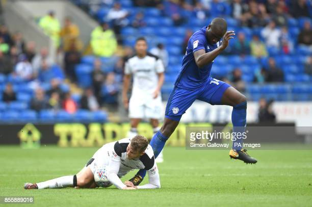 Cardiff City's Sol Bamba and Derby County's Johnny Russell battle for the ball during the Sky Bet Championship match at Cardiff City Stadium