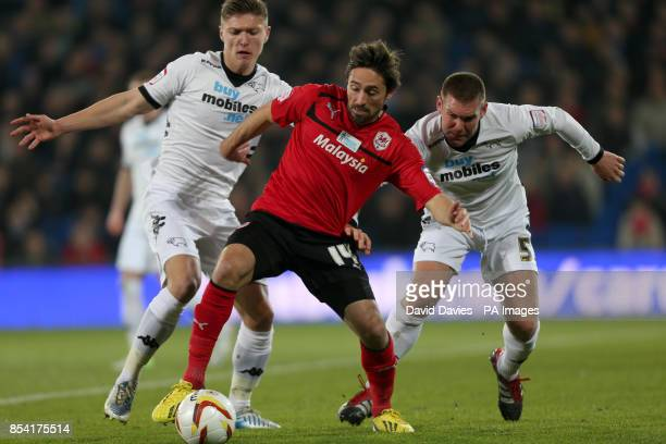 Cardiff City's Tommy Smith is challenged by Derby County's Jeff Hendrick and Jake Buxton during the npower Championship match at the Cardiff City...