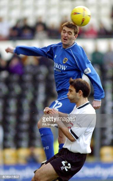 Cardiff City's Willie Boland climbs above Derby County's Marco Reich during the Nationwide Division One match at Pride Park Derby THIS PICTURE CAN...