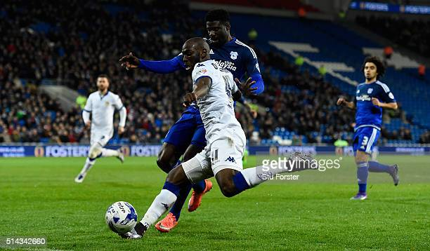 Cardiff defender Bruno Manga challenges Leeds forward Souleymane Doukara during the Sky Bet Championship match between Cardiff City and Leeds United...
