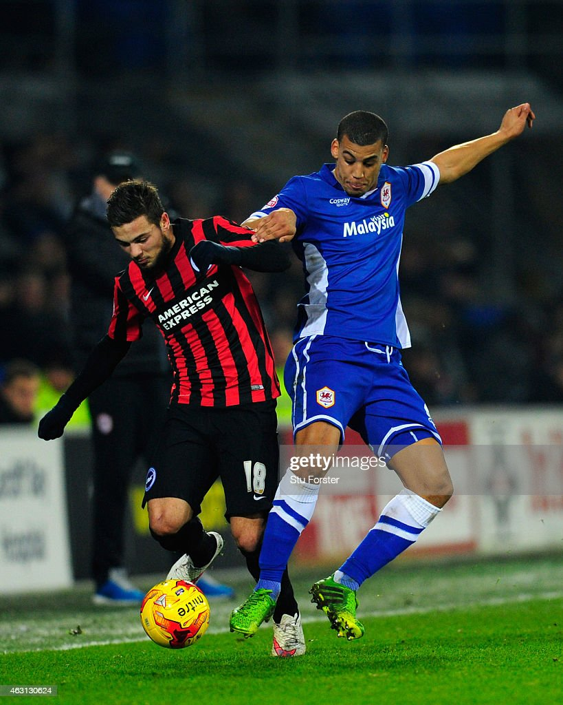 Cardiff defender <a gi-track='captionPersonalityLinkClicked' href=/galleries/search?phrase=Lee+Peltier&family=editorial&specificpeople=1007594 ng-click='$event.stopPropagation()'>Lee Peltier</a> (r) challenges Jake Forster- Caskey of Brighton during the Sky Bet Championship match between Cardiff City and Brighton & Hove Albion at Cardiff City Stadium on February 10, 2015 in Cardiff, Wales.