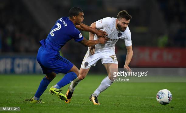 Cardiff defender Lee Peltier challenges Stuart Dallas of Leeds during the Sky Bet Championship match between Cardiff City and Leeds United at Cardiff...