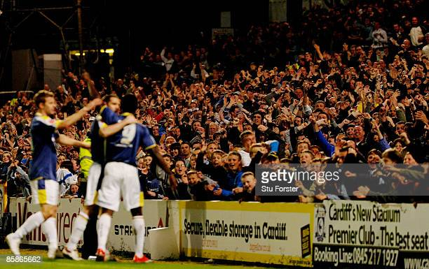 Cardiff fans celebrate after forward Eddie Johnson scored the fourth Cardiff goal during the Coca Cola Championship match between Cardiff City and...