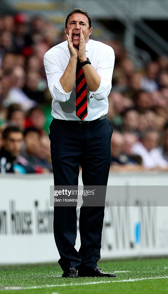 Cardiff manager Malky MacKay gives instructions during the Barclays Premier League match between Cardiff City and Tottenham Hotspur at Cardiff City Stadium on September 22, 2013 in Cardiff, Wales.