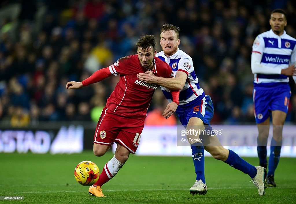 Cardiff player Adam Le Fondre is fouled by Reading player Alex Pearce who is then red carded during the Sky Bet Championship match between Cardiff...
