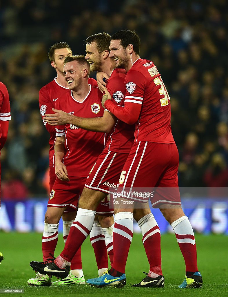 Cardiff player Ben Turner celebrates with team mates after Reading player Alex Pearce had put into his own net for the opening goal during the Sky...