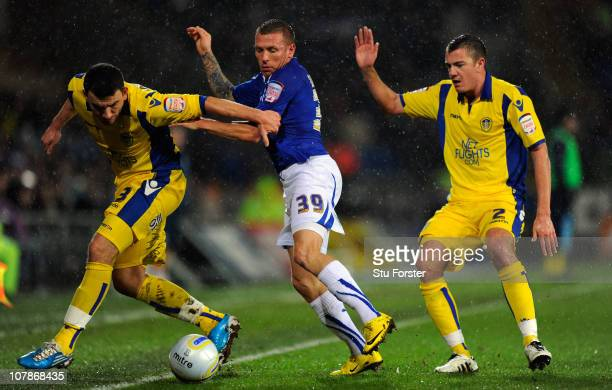 Cardiff player Craig Bellamy challenges Leeds players Robert Snodgrass and Paul Connolly during the npower Championship game between Cardiff City and...