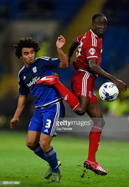 Cardiff player Fabio da Silva challenges Albert Adomah of Boro during the Sky Bet Championship match between Cardiff City and Middlesbrough at...