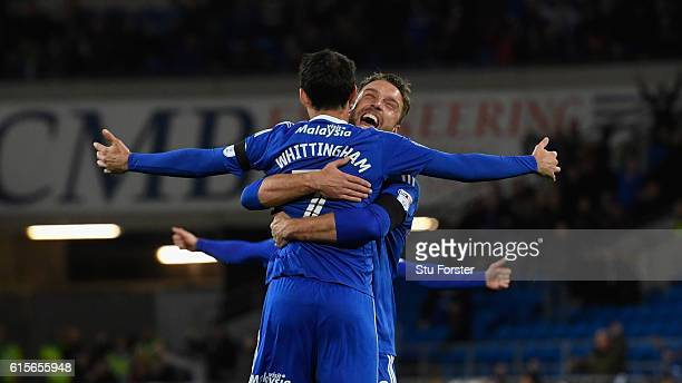 Cardiff player Peter Whittingham is congratulated by Rickie Lambert after scoring the opening goal from a free kick during the Sky Bet Championship...