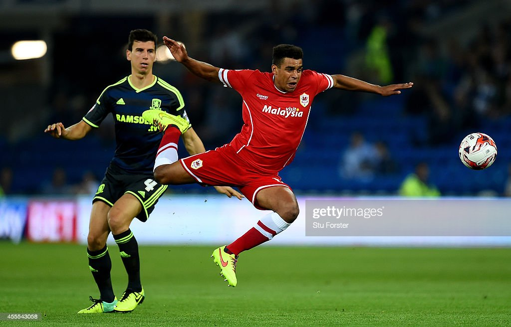 Cardiff player Tom Adeyemi (r) is fouled by Daniel Ayala of Middlesbrough during the Sky Bet Championship match between Cardiff City and Middlesbrough at Cardiff City Stadium on September 16, 2014 in Cardiff, Wales.