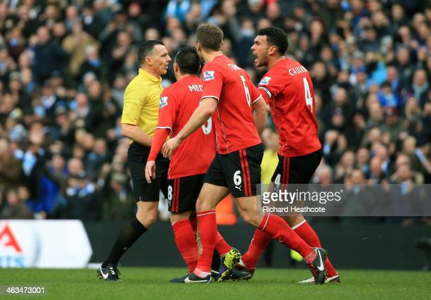 Cardiff players complain to referee Neil Swarbrick that the goalscoring shot from Edin Dzeko of Manchester City did not cross the goal line during...