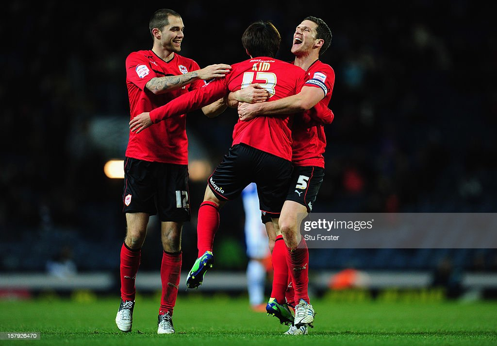 Cardiff players Matthew Connolly and Mark Hudson congratulate Kim BoKyung on his goal during the npower Championship match between Blackburn Rovers...
