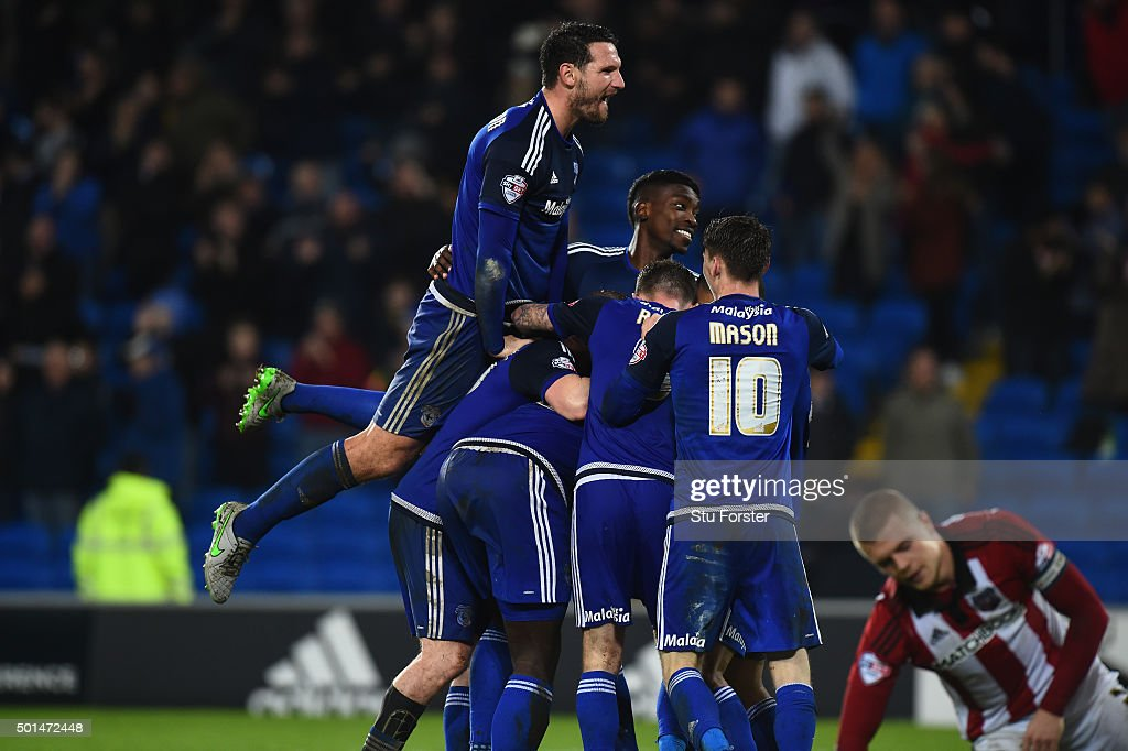 Cardiff players mob Scorer of the third goal Kenwyne Jones during the Sky Bet Championship match between Cardiff City and Brentford at Cardiff City...