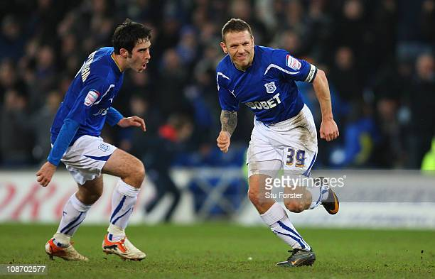 Cardiff striker Craig Bellamy celebrates with Peter Whittingham after scoring a last second goal to draw the game during the npower Championship...
