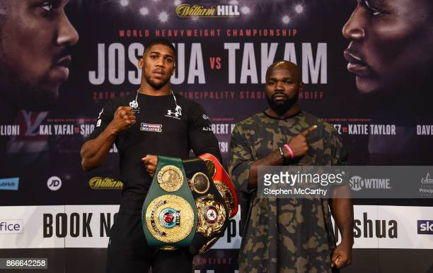 Cardiff United Kingdom 26 October 2017 Anthony Joshua and Carlos Takam square off following a press conference at the National Museum Cardiff ahead...