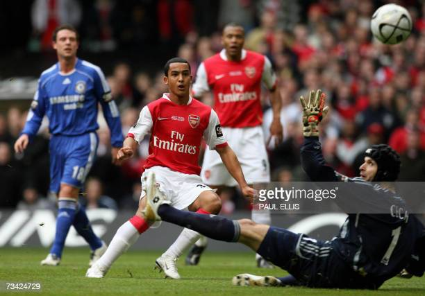 Arsenal's English forward Theo Walcott scores past Chelsea's Czech goalkeeper Petr Cech during the English League Cup Final football match at The...