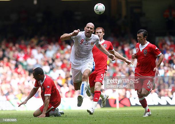 Czech striker Jan Koller tries to find a way past Wales' Danny Gabbidon James Collins and Simon Davies during their Euro 2008 qualifying match at the...