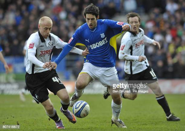 Cardiff's Peter Whittingham and Swansea's David Cotterill in action during the CocaCola Championship match at Cardiff City Stadium Cardiff