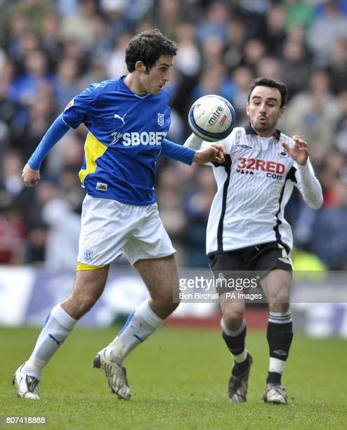 Cardiff's Peter Whittingham and Swansea's Leon Britton in action during the CocaCola Championship match at Cardiff City Stadium Cardiff
