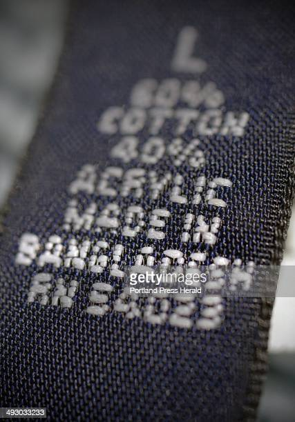 A cardigan sweater sold by an American retailer has a 'Made in Bangladesh' label inside Wednesday July 31 2013