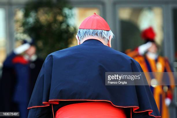 A cardinal arrives at the Paul VI hall for the opening of the Cardinals' Congregations on March 4 2013 in Vatican City Vatican The congregations of...