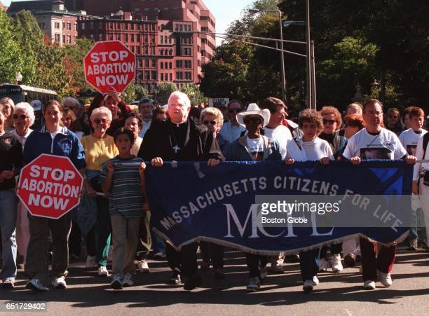 Cardinal Bernard Law left center holding sign marches with hundreds in the Respect For Life 5k walk in Boston on Oct 4 1998