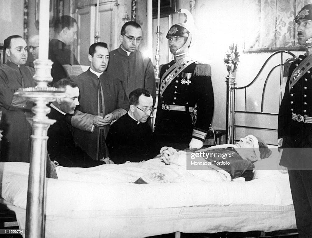 Cardinal Carlo Confalonieri, Monsignor Diego Venini, Monsignor Giovanni Battista Nasalli Rocca di Corneliano and Monsignor Federico Callori di Vignale assisting <a gi-track='captionPersonalityLinkClicked' href=/galleries/search?phrase=Pope+Pius+XI&family=editorial&specificpeople=93954 ng-click='$event.stopPropagation()'>Pope Pius XI</a> on his deathbed. Vatican City, 10th November 1939
