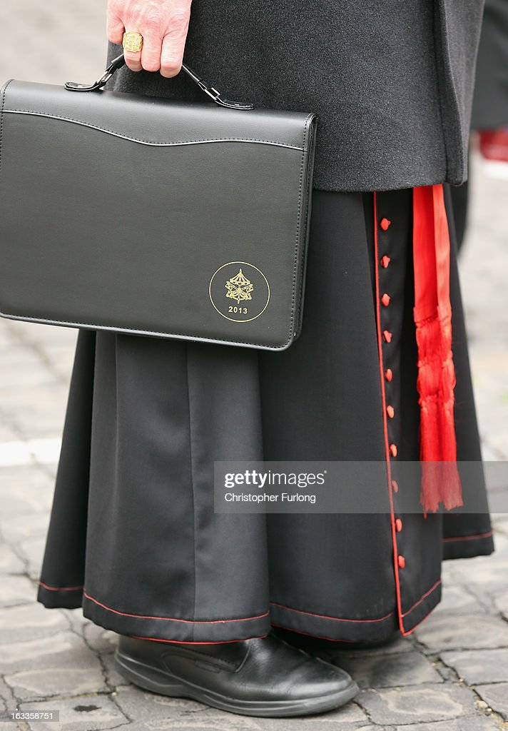 A Cardinal carries his 2013 conclave attache case as he arrives for their eighth congregation at the Paul VI Hall inside the Vatican on March 8, 2013 in Vatican City, Vatican. The Holy See has announced that cardinals will begin electing a new Pope early next week after Pope Benedict XVI retired last month after nearly eight years in office.
