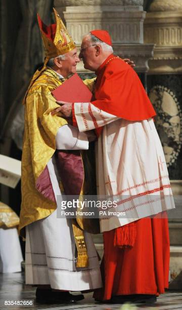 Cardinal Cormac Murphy O'Connor congratulates the newly installed Archbishop of Westminster Vincent Nicols at Westminster Cathedral central London...