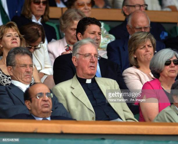 Cardinal Cormac Murphy O'Connor watches from the Royal Box as Belgium's Justine HeninHardenne plays against Belgium's Kim Clijsters during the...