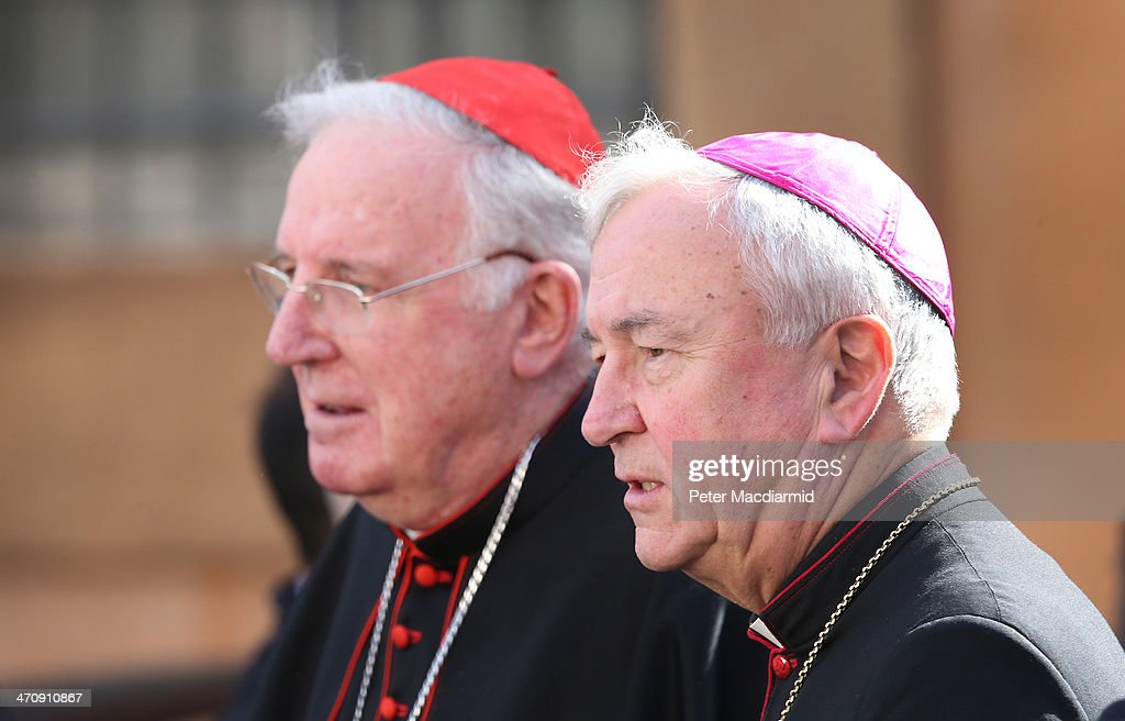Cardinal Cormac Murphy-O'Connor (L) leaves the Extraordinary Consistory with Cardinal Designate, Archbishop Vincent Nichols on February 21, 2014 in Vatican City, Vatican. Pope Francis will create 19 new cardinals in a ceremony tomorrow in St Peter's Basilica.