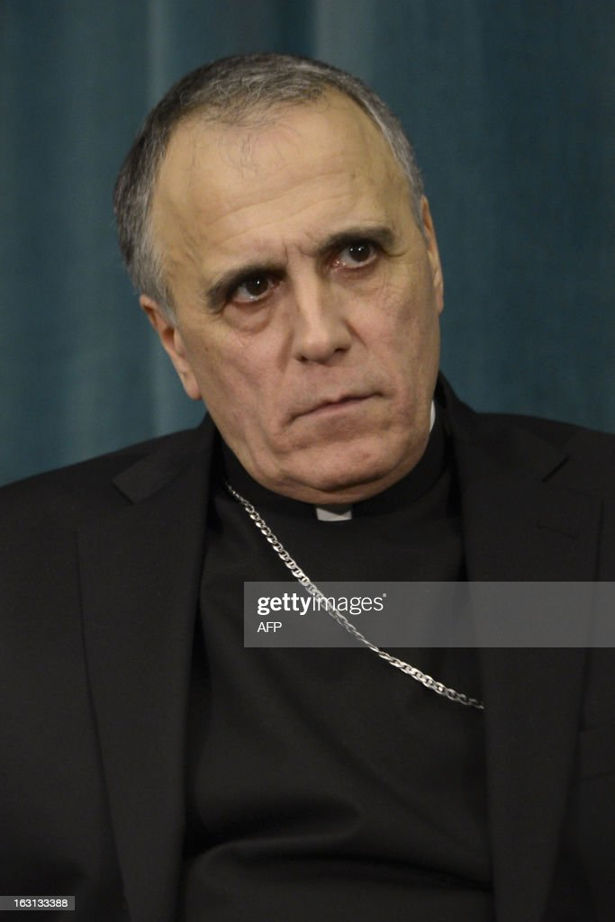 US cardinal Daniel DiNardo listens during a press conference at the North American College on March 5, 2013 in Rome. The Vatican said Tuesday that the date for the conclave to elect a new pope could be set before all cardinals have arrived in Rome, as five electors were still missing from the roll call. AFP PHOTO / ANDREAS SOLARO