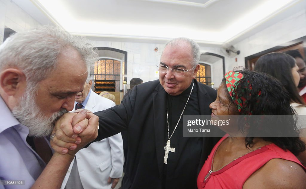 Cardinal Dom Orani Tempesta (C), archbishop of Rio de Janeiro, greets celebrants during celebrations for Sao Jorge Day on April 23, 2015 in Rio de Janeiro, Brazil. Sao Jorge (Saint George) is the patron saint of Portugal, which colonized Brazil, and the faithful believe Sao Jorge provides protection from evil. Sao Jorge is also an important figure in the Afro-Brazilian religion Umbanda.