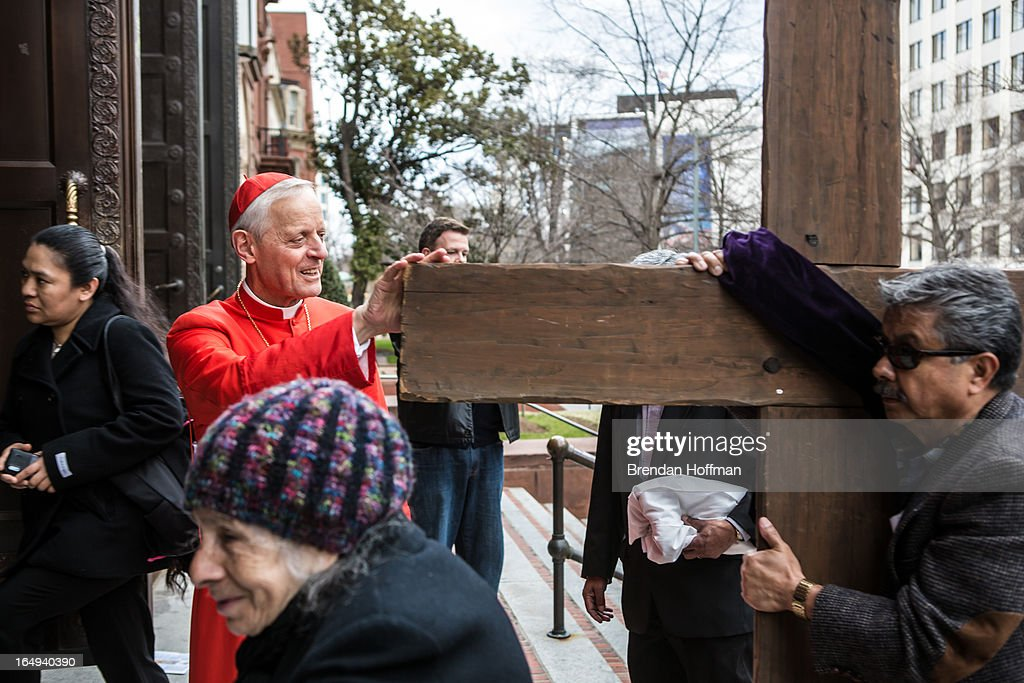 Cardinal Donald Wuerl, Archbishop of Washington, greets Catholics after their march through downtown on Good Friday in the Via Crucis, or Way of the Cross procession on March 29, 2013 in Washington, DC. The event is one of many Holy Week activities in the lead up to Easter Sunday.