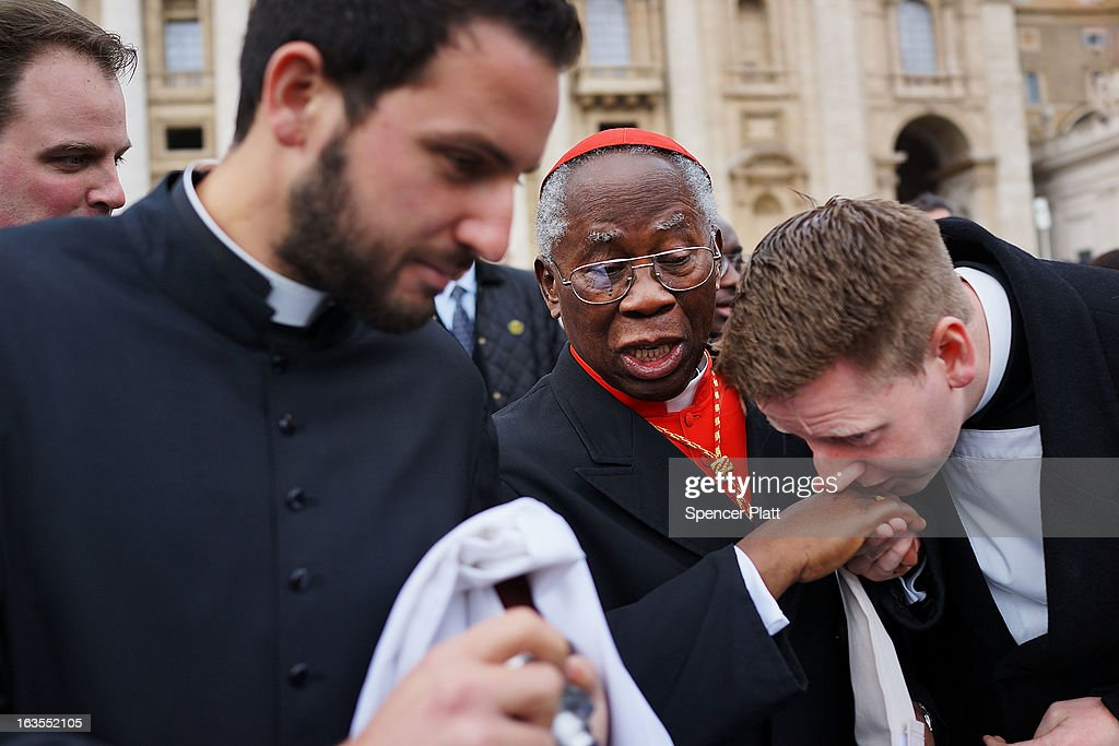 Cardinal <a gi-track='captionPersonalityLinkClicked' href=/galleries/search?phrase=Francis+Arinze&family=editorial&specificpeople=1039356 ng-click='$event.stopPropagation()'>Francis Arinze</a>, 80, of Nigeria exits St Peter's Basilica after he attended the Pro Eligendo Romano Pontifice Mass before he and the other Cardinals will enter the conclave to decide who the next pope will be on March 12, 2013 in Vatican City, Vatican. Cardinals are set to enter the conclave to elect a successor to Pope Benedict XVI after he became the first pope in 600 years to resign from the role. The conclave is scheduled to start on March 12 inside the Sistine Chapel and will be attended by 115 cardinals as they vote to select the 266th Pope of the Catholic Church.