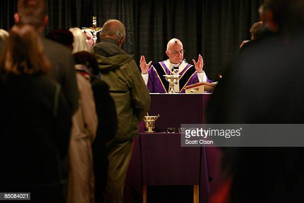 Cardinal Francis George Chicago's eighth archbishop celebrates Ash Wednesday Mass in the cafeteria of Holy Name Cathedral February 25 2009 in Chicago...