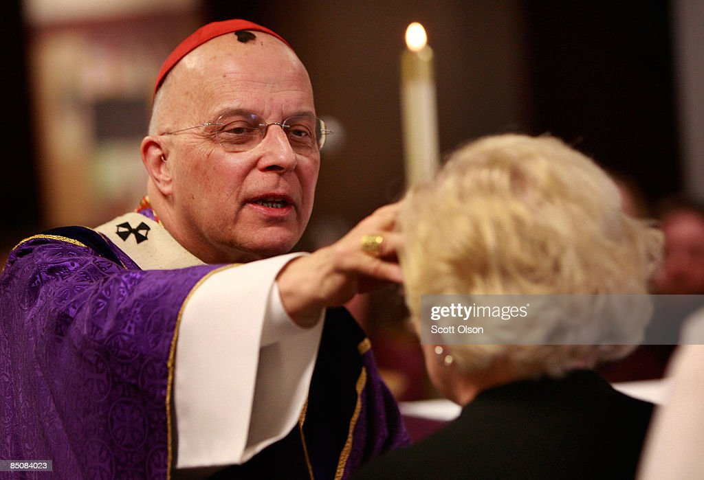 Cardinal Francis George Chicago's eighth archbishop use ashes to mark a cross on the forehead of a parishioner during an Ash Wednesday Mass in the...