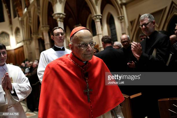 Cardinal Francis George leaves the installation for Blase Cupich to become the next Archbishop of Chicago at Holy Name Cathedral during the Liturgy...